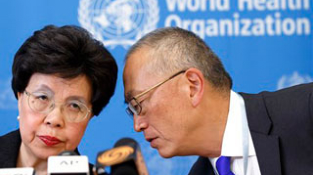 Director General of the World Health Organization, WHO, China's Margaret Chan and Assistant Director General for Health Security Keiji Fukuda of the US, right, share a word during a press conference after an emergency meeting at the headquarters of the WHO in Geneva, Switzerland, Friday, Aug. 8, 2014. (AP Photo/Keystone, Salvatore Di Nolfi)