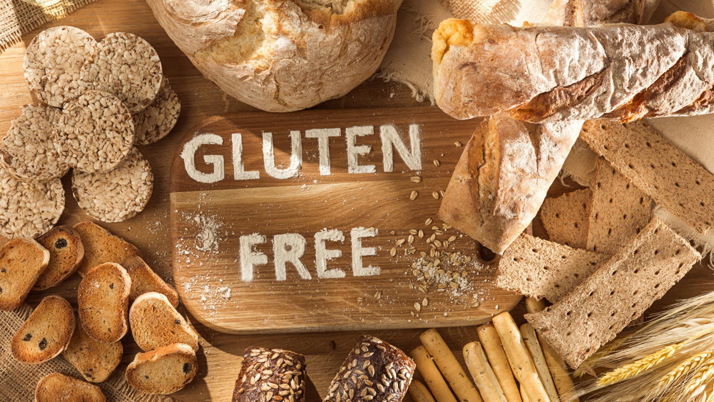 Gluten free food. Various pasta, bread and snacks on wooden background from top view. Healthy and diet concept.