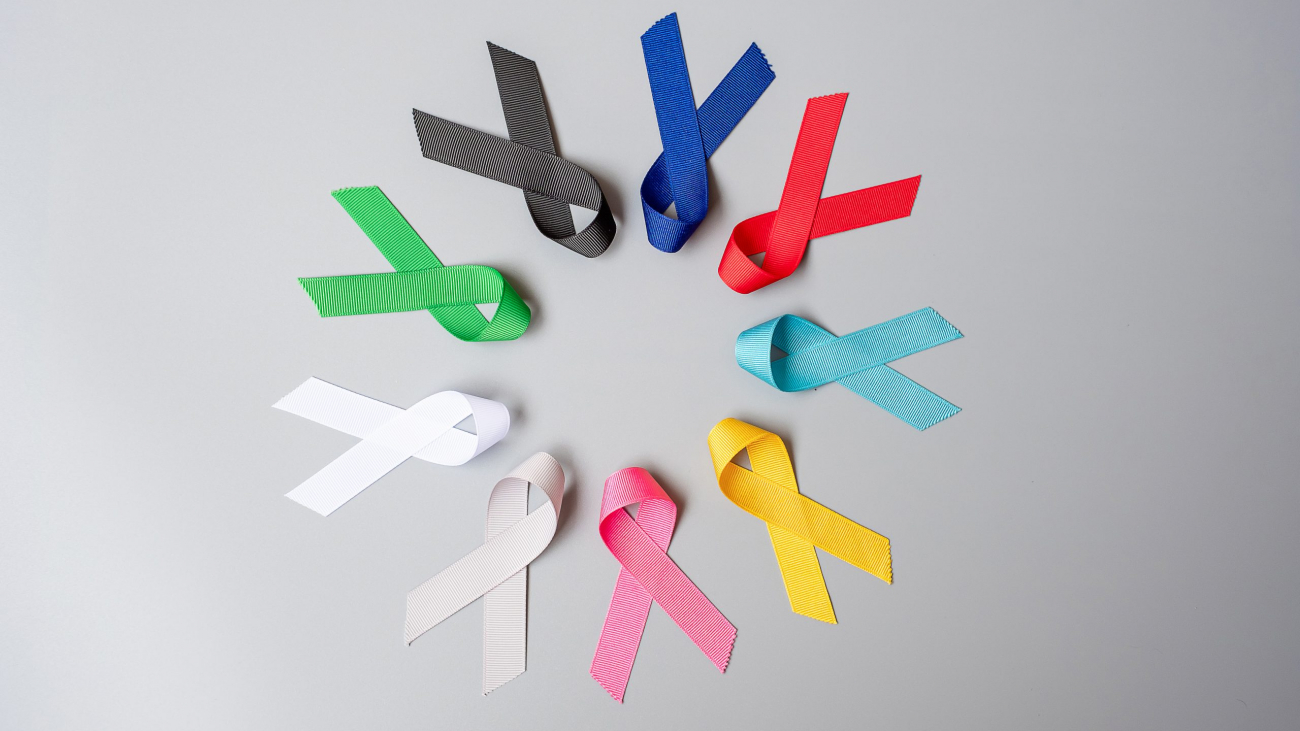 World cancer day (February 4). colorful awareness ribbons; blue, red, green, black, grey, white, pink and yellow color for supporting people living and illness. Healthcare and medical concept