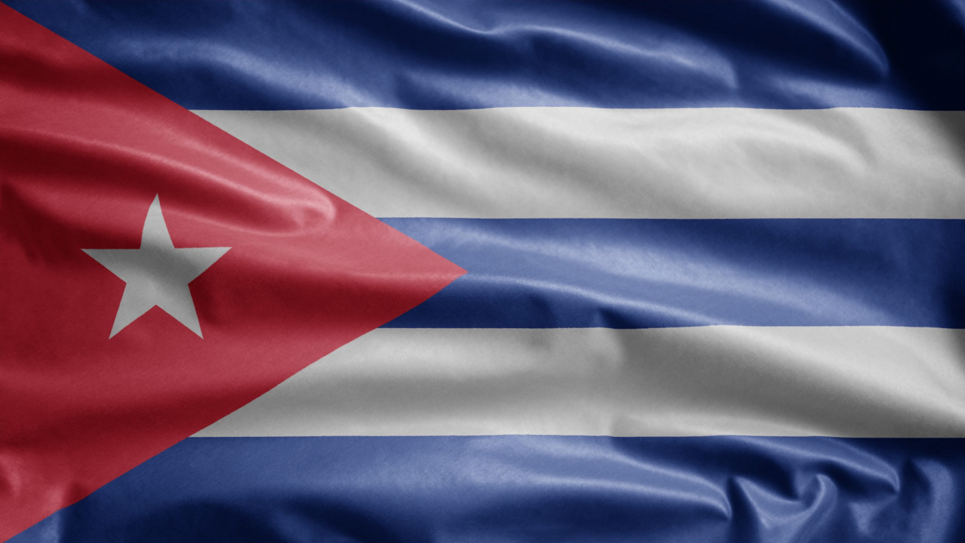 Cuban flag waving in the wind. Close up of Cuba banner blowing, soft and smooth silk. Cloth fabric texture ensign background.